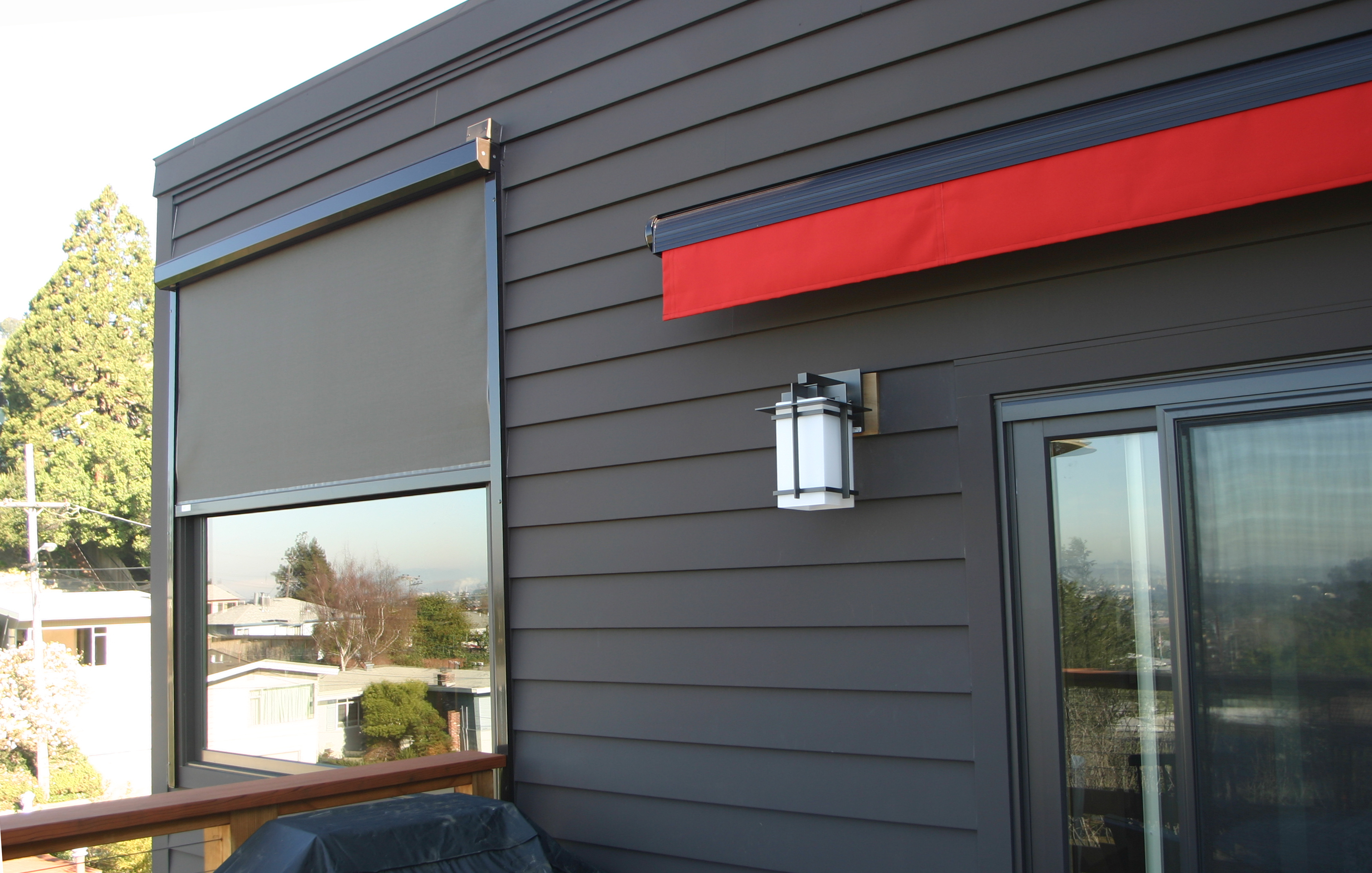 Exterior window shades and awning retracted and fibercement siding