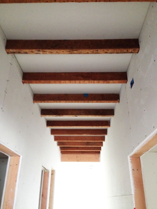 hallway ceiling with joists exposed