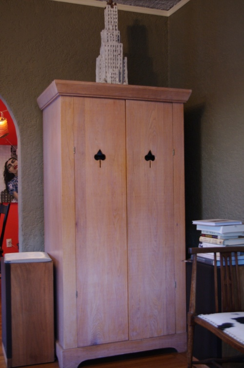 spade cutout pulls (Armoire by Dickson Schneider I believe)