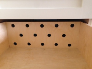 Holes drilled to vent drawers to the outside. California living!
