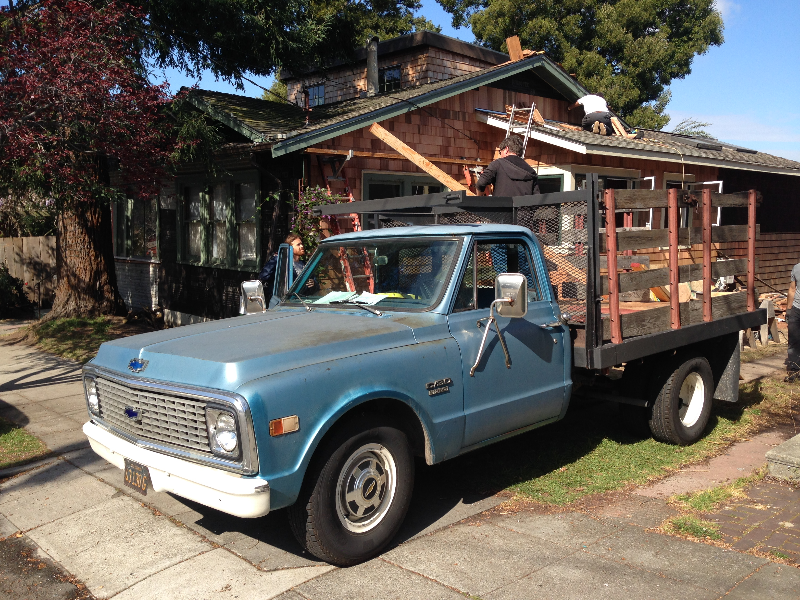 Blue Chevy and new red cedar shingles